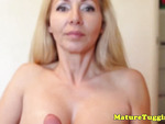 Mature tugging milf uses tits to give handjob