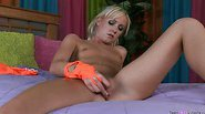 Blond chick Alexia Sky using her vibrator on her bed