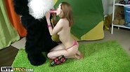 Cute girl plays with sexy toys and bear