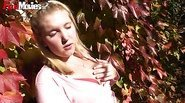 Big blonde girl rubs her pussy in the garden