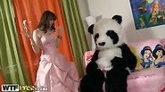 Young fairy revived toy panda and suck