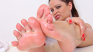 Brunette babe shows off her fuckable bare foot
