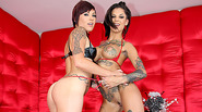 Inked lesbos strapon fucking their asses