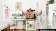Fat Mature masturbating with dildo in medical room