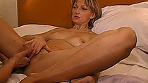 Brunette MILF can fit her whole fist into her girlfriend's wet pussy