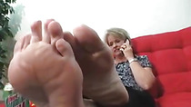 Mature sweaty feet in stocking on the table