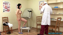 Carly strips in the clinic while Dr. Arnold watches