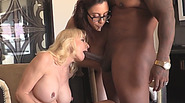 Tattooed MILF Cammille Shares Huge Black Dick With Sexy Brunette Roxanne Rae