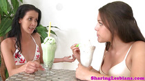 Lesbian couple in bikinis lick pussy after drinking milkshakes