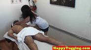 Asian handjob masseuse tugging on client dick