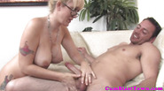 Bukkake loving mature tugging a cock pov
