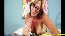 Busty cougar tugs a young cock closeup