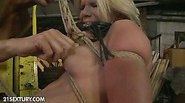 Tied up in a construction yard Bianka Lovely screams and...