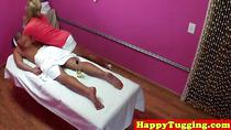 Blonde asian handjob masseuse tugging her client