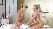 Blonde lesbians fingering in massage room