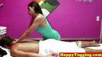 Busty asian masseuse tugging cock before riding