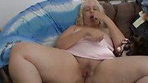 Mature woman fingering alone