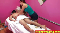 Asian masseuse tugging on client for cash