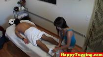 Busty asian handjob masseuse jerking client