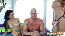 Two gorgeous chicks seduce bald guy into getting drilled by their strapons