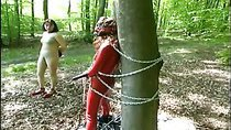 Hot domina punishes her slaves outdoors