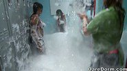 Beautiful girls getting fresh and clean in an awesome foam party.