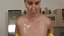 Horny naked lady plays with her oiled big boobs and rubs her clit!