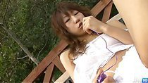 Horny little Asuka Ishihara in her backyard fingering her pussy in the sun