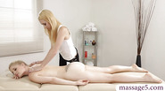 Two blonde women clit to clit fucking on massage table