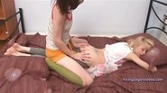 Two girls toying with green dildo