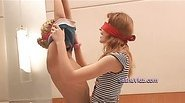 Blindfolded babes teasing each other