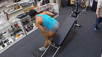New definition of exercise by fit woman at pawnshop for pawning lifting set