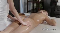 Brunette and masseuse lick and finger